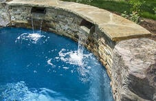 scuppers-on-rustic-swimming-pool