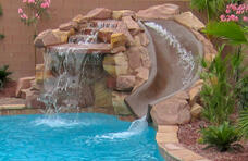small-grotto-with-slide-on-pool