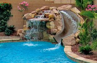 small-rock-waterfall-with-masonry-slide-on-swimming-pool