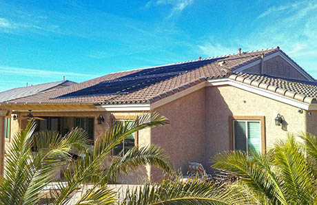solar-swimming-pool-heating-system-panels-on-roof.jpg