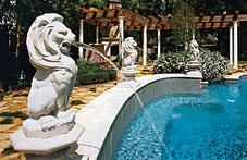 spouting-lion-statue-on-swimming-pool