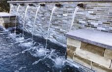 spouts-across-glass-tiled-pool-wall