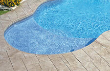 stamped-concrete-cantilever-coping-on-pool