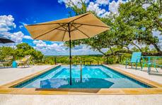 swimming-pool-tanning-shelf-with-umbrella