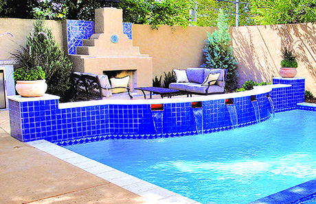 swimming_pool_wiht_outdoor_fireplace_and_seating_area.jpg