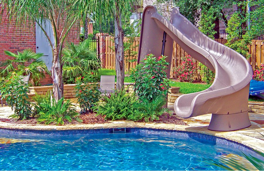 tan-curved-inground-pool-slide-with-landscape