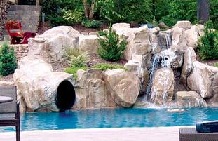 tunnel-slide-rock-waterfall-on-pool