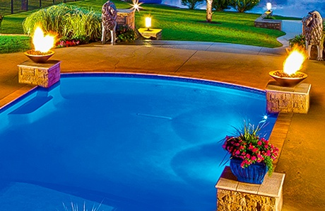 twin-fire-bowls-atop-pedestals-on-swimming-pool