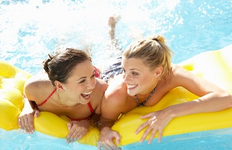 two-friends-on-inflatable-pool-float.jpg