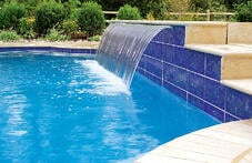 wide-cascade-waterfall-on-pool