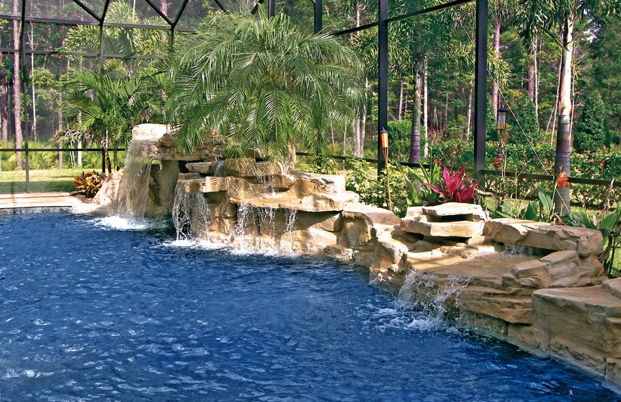 tropical-dark-bottom-pool-with-faux-rock-waterfall