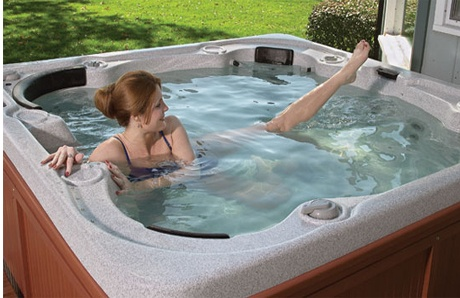 woman exercising in hot tub