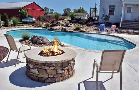 Round fire pit with fieldstone and lava rock
