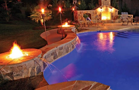 Twin firepits with pool wall seating