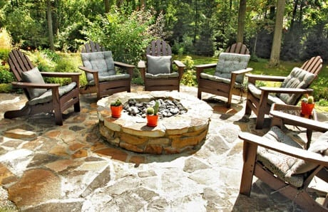 Rustic fire pit with stone to match pool deck