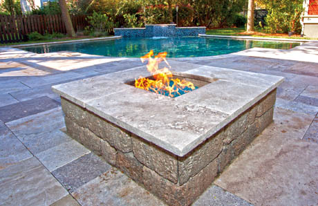 Square fire pit with travertine stone and fire glass