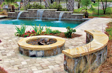 Flagstone fire pit with bench seating wall