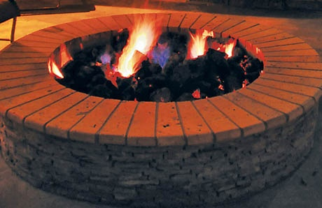 Fire pit topped with curved bullnose stone