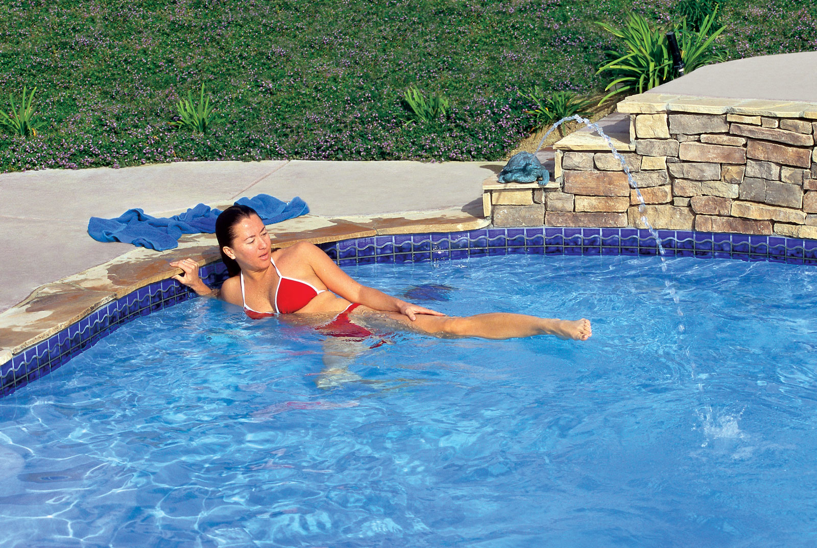 Woman Exercising in a Blue Haven Pool