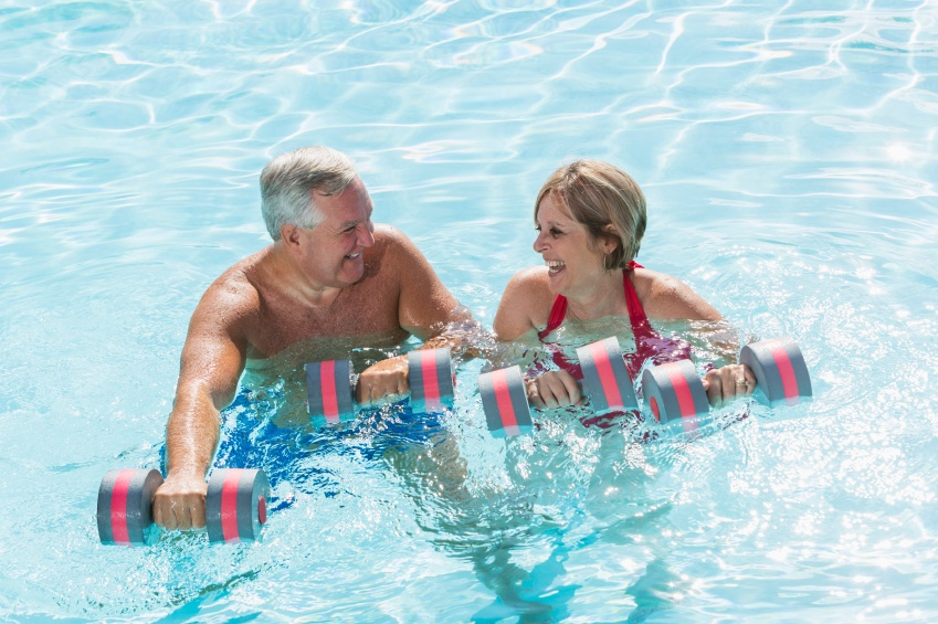 Two people doing swimming pool exercises