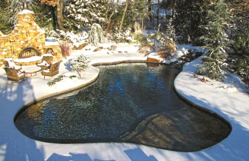 Swimming pool surrounded by snow