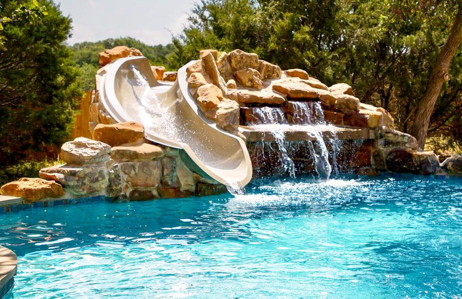 stone-waterfall-grotto-slide-on-swimming-pool